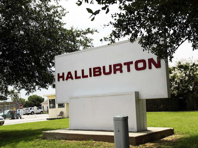 FORT WORTH, TX -JULY 10:  A sign for of Halliburton Co. is seen June 10, 2002 in Fort Worth, Texas. Judicial Watch announced that they will file a shareholders lawsuit in North Texas against U.S. Vice President Dick Cheney and his former employer, Halliburton Co. Judicial Watch claims that Cheney and Halliburton Co. overstated company revenues. Cheney was chairman and chief executive of the oil field services giant from 1995 to 2000.  (Photo by Ronald Martinez/Getty Images)