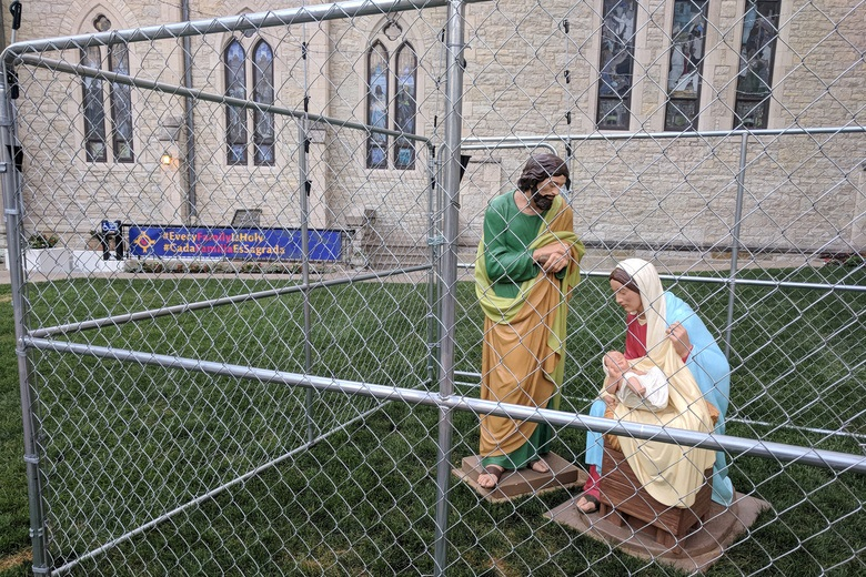 The statues of Jesus, Mary and Joseph are seen in a cage as a protest of child separation policy, in Indianapolis, Indiana, U.S., July 2, 2018 in this picture obtained from social media. Picture taken July 2, 2018. Christ Church Cathedral Indianapolis/via REUTERS THIS IMAGE HAS BEEN SUPPLIED BY A THIRD PARTY. MANDATORY CREDIT. NO RESALES. NO ARCHIVES     TPX IMAGES OF THE DAY - RC170C0B24B0
