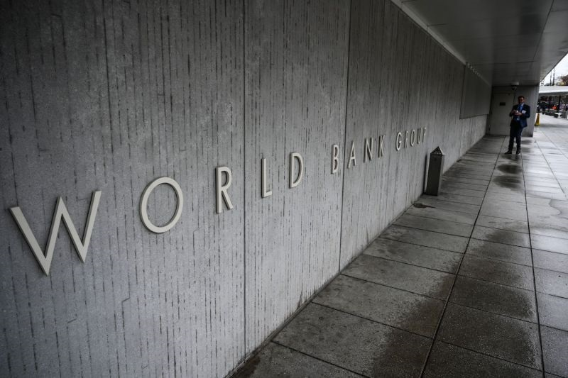 A person walks by the building of the Washington-based global development lender, The World Bank Group, in Washington on January 17, 2019. - World Bank current President Jim Yong Kim announced on January 7, 2019, that he would cut short his tenure as president more than three years before his second term was to end. The World Bank Board said it would start accepting nominations for a new leader early next month and name a replacement for Kim by mid-April 2019. (Photo by Eric BARADAT / AFP)        (Photo credit should read ERIC BARADAT/AFP/Getty Images)